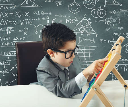 Concept of young genius that works with abacus