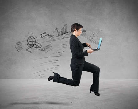 Concept of fast business with running businesswoman photo