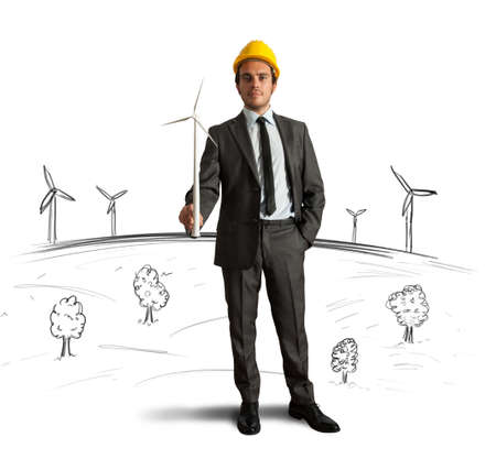 alternative energy sources: Businessman thinks about wind turbine energy project