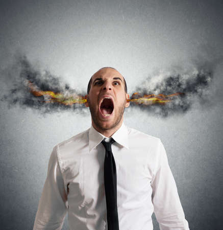 headache: Stressed businessman with smoke and flame in head
