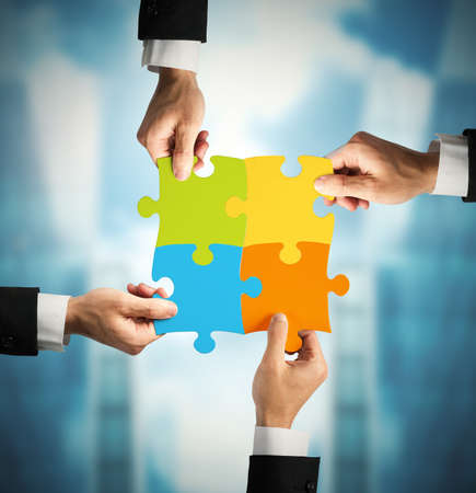 solutions: Businessman with puzzle. Concept of teamwork and partnership concept Stock Photo