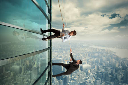 Concept of competition with climbing businessman Imagens