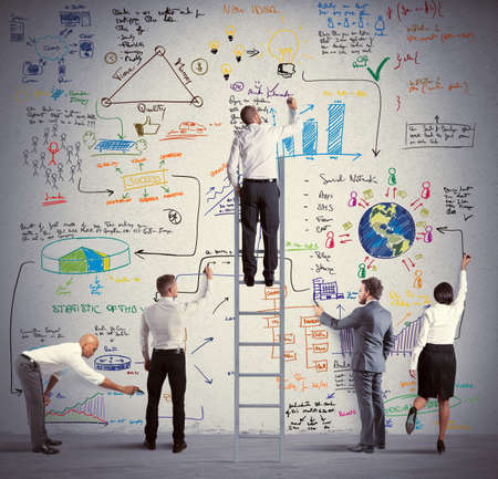 Business team drawing a new big project Stock Photo