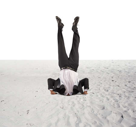 Concept of economic downfall with businessman upside down
