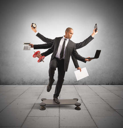 acrobat: Multitasking concept with businessman at work doing gymnastics Stock Photo