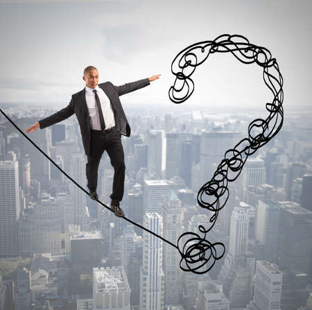 financial obstacle: Problem and difficulty concept with businessman on the rope