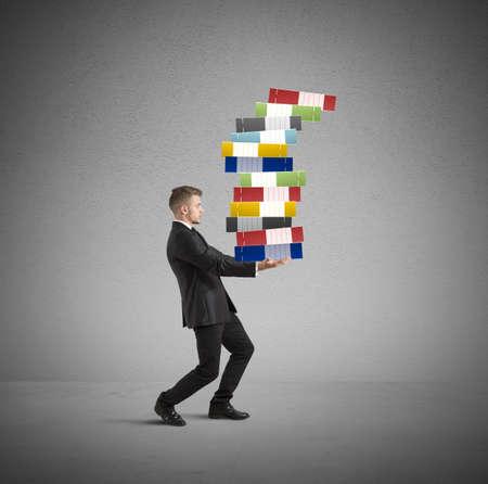 Concept van de harde carrière met werklast zakenman Stockfoto