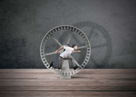 wheel: Concept of business loop with running businessman