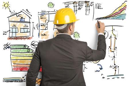 effizient: Ingenieur, der die Energieeffizienz eines Hauses berechnet Lizenzfreie Bilder