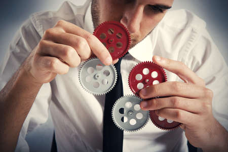 conjunction: Concept of build a business system with gear Stock Photo