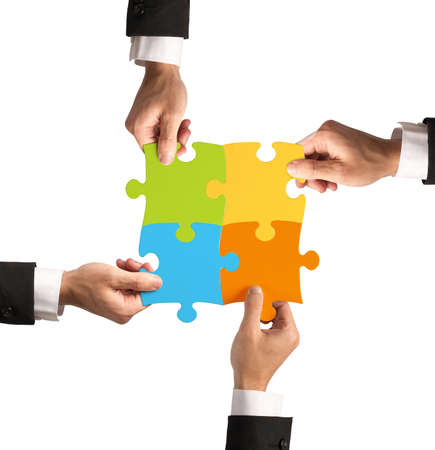 merging together: Businessman with puzzle. Concept of teamwork and partnership concept Stock Photo