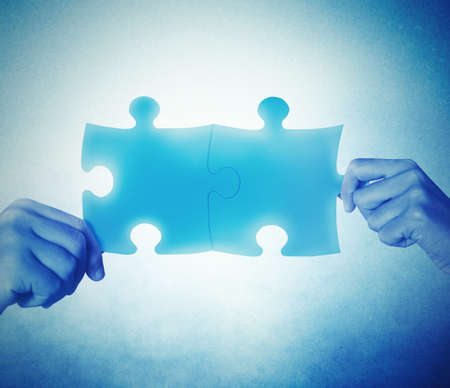 Teamwork and integration concept with joining puzzle photo