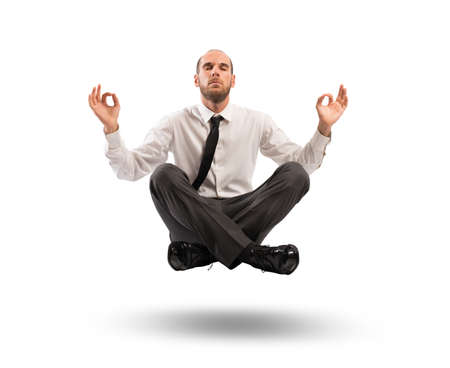Concept of relax with businessman doing yoga photo