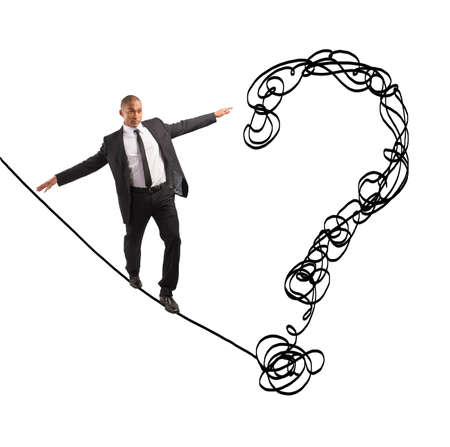 Problem and difficulty concept with businessman on the rope photo