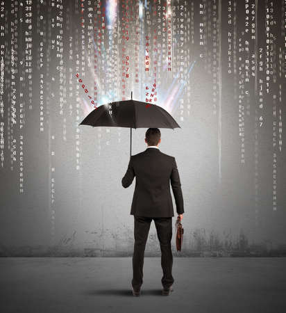 Antivirus and firewall concept with businessman protected with umbrella photo