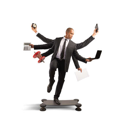 Multitasking concept with businessman at work doing gymnastics Фото со стока