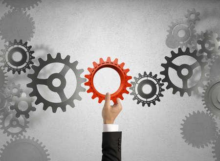 ビジネスマンはギアとビジネス システムを構築します。