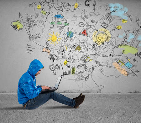 data flow: Boy woks with a laptop for new ideas Stock Photo