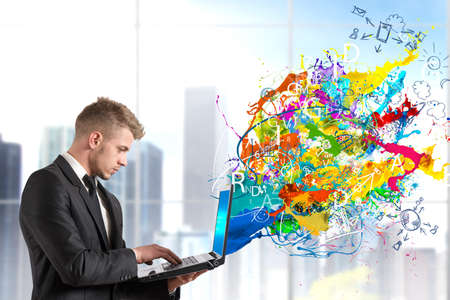 creative artist: Creative technology with colorful effect that exit from a  table Stock Photo