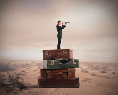 Concept of travel with businessman with binocular photo
