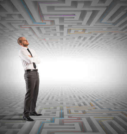 confuse: Confused business man seeks a solution to the labyrinth Stock Photo