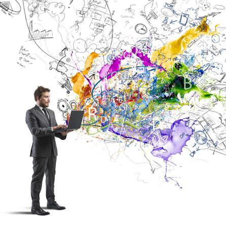 creativity: Бизнесмен, работающих с ноутбуком с творческой идеи Фото со стока