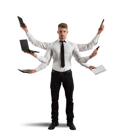 Concept of multitasking with busy businessman at work photo