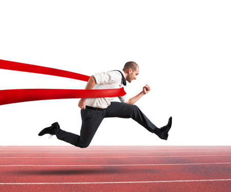 Successful businessman on the finishing line of a track photo