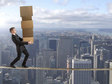 Concept of difficult career in business with businessman on the rope photo