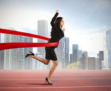 competitive: Concept of winner businesswoman in a finish line