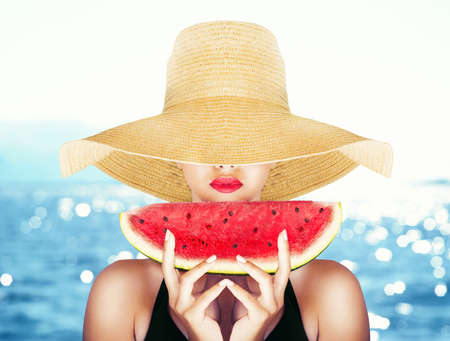 Fashion portrait with a sexy girl with watermelon photo