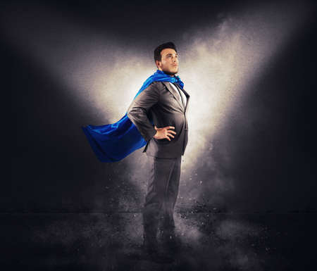 Concept of successful businessman like a super hero photo