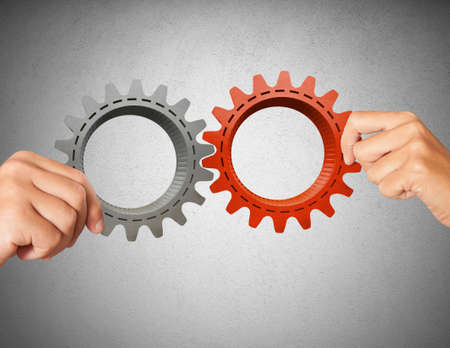 partnership power: Businessman builds a business system with gear Stock Photo