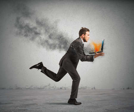internet attack: Concept of stress with running businessman with a burning laptop