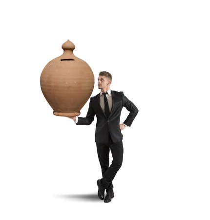 Concept of success with businessman that holds a piggy bank photo