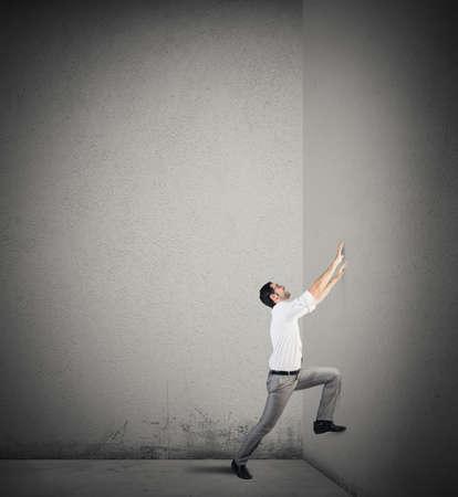 tries: Man tries to climb the walls smooth