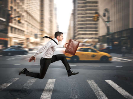 Concept of fast business with running businessman photo