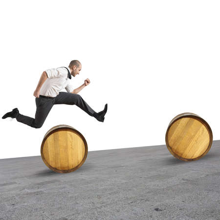 Concept of difficulty with businessman that jumps obstacles photo