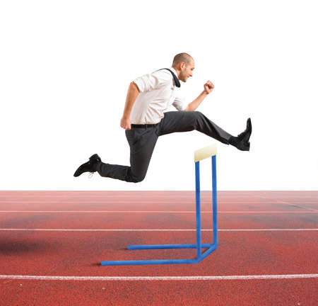 Concept of business difficulty with jumping businessman photo