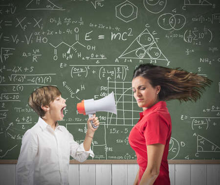 Child yells at her teacher with megaphone photo
