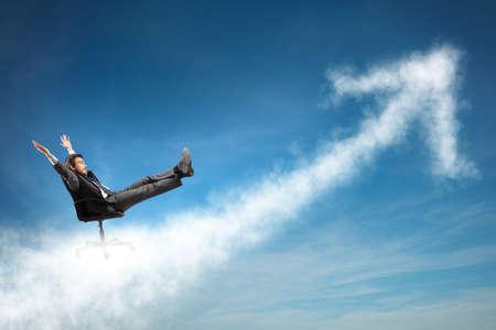 business improvement: Successful businessman over a cloud like an arrow