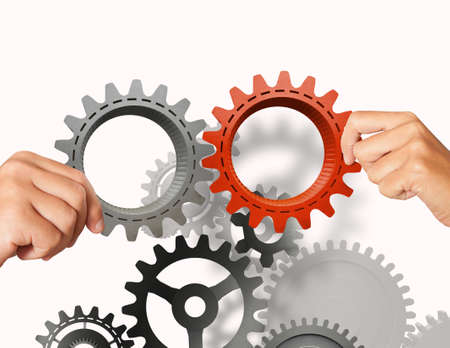 in conjunction: Businessman builds a business system with gear Stock Photo