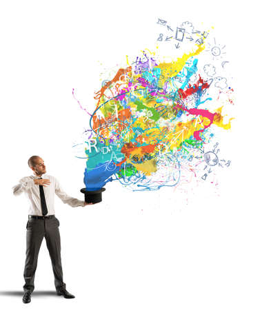 Creative businessman with colors coming out of the hat photo