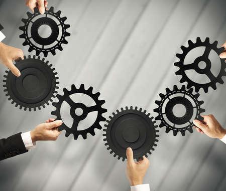Teamwork en integratie concept met aansluiting van het vistuig