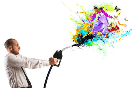 surtidor de gasolina: Concepto de energía limpia con el empresario y el combustible de la bomba Foto de archivo
