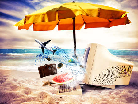 Concept of vacation time with an old computer on the beach