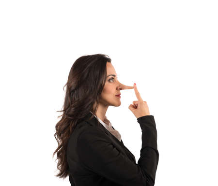 Concept of lie with businesswoman with long nose photo