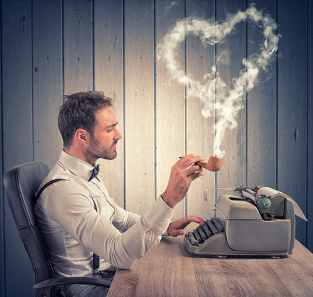 A man writing a love letter for valentine day Stock Photo