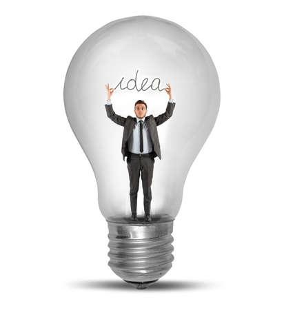 Businessman holding an idea inside a lightbulb photo