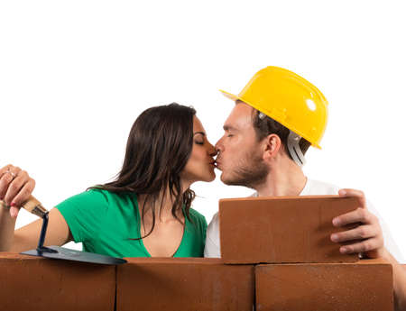 Concept of love with a couple that builds a house with brick photo